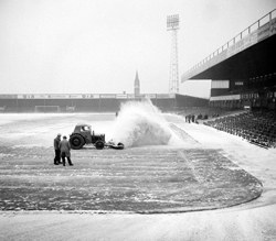 Clearing the pitch of snow at Birmingham City